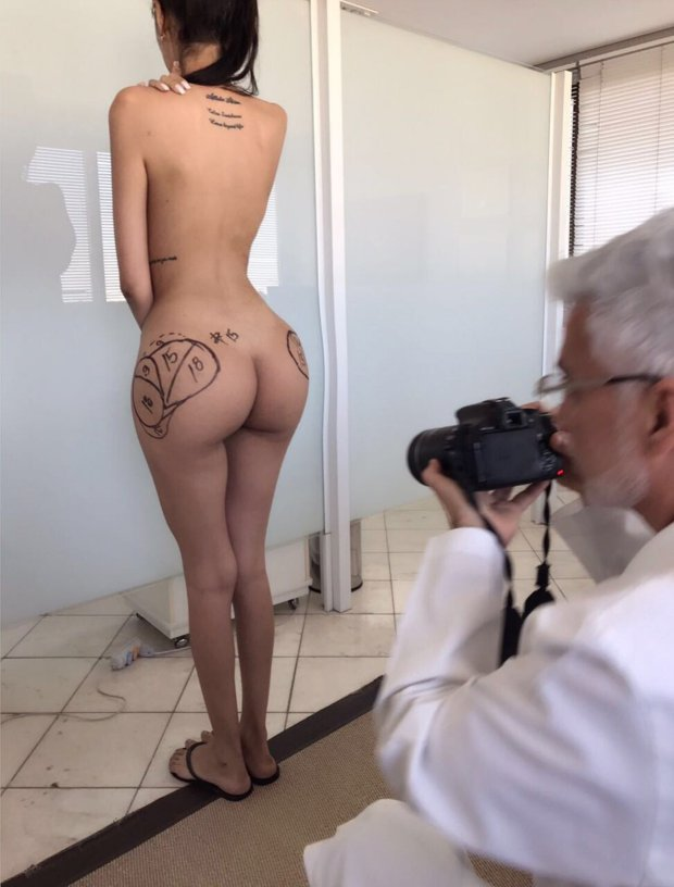 PICS BY JENNIFER PAMPLONA / CATERS NEWS - (PICTURED: Jennifers butt just before most recent surgery that now means she has 900cc in each butt cheek - a total of four pints) - - A Kim Kardashian lookalike poses for naked shoot after recent face altering surgery brings total spent imitating idol to HALF A MILLION DOLLARS. Jennifer Pamplona, 25, from Sao Paolo, Brazil, glows as she shows off her curvaceous figure covered in only glittery paint for a shoot inspired by the Keeping Up With The Kardashians star. She has spent a staggeringUSD500,000(350kGBP) transforming close to every inch of her body, from having four ribs removed to four pints (900cc) of fat injected into her butt. Recently she went under the knife again for her second nose job, to remove cheek fillers and had a face lift to closely resemble the Break the Internet model. The diva doppelganger has just recovered from the USD30k (21kGBP) procedures with Dr Bulent Cihantimur, in Turkey, that initially left her unable to smile. The entrepreneur already has future plans to increase the size of her extremely enlarged derriere further, despite doctors rejecting the idea. She believes she will be able to model way into her late 60s thanks to the alterations and finally likes posing naked, as seen in her shoot imitating Kim Kardashian-Wests photos for KKW Beauty. - SEE CATERS COPY